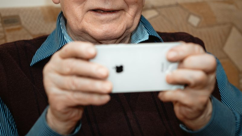 Older man looking at a mobile phone
